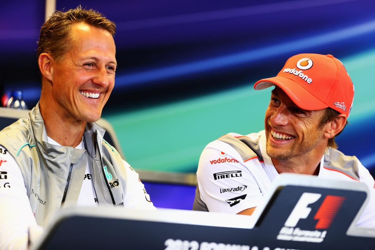 Michael Schumacher e Jenson Button (Getty Images)