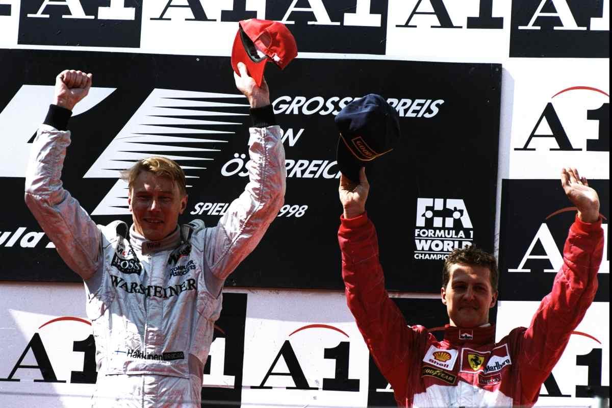 Mika Hakkinen sul podio con Michael Schumacher. Mandatory Credit: Mike